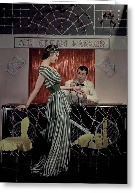 A Model At An Ice Cream Parlor Greeting Card by John Rawlings