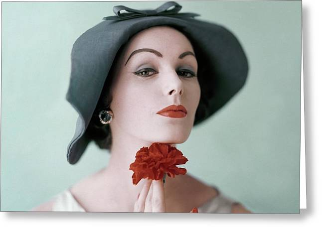 A Model Wearing A Hat And Holding A Flower Greeting Card by Karen Radkai