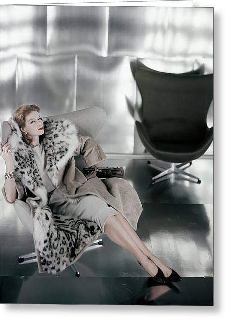 A Model Wearing A Snow Leopard Coat Greeting Card by Henry Clarke