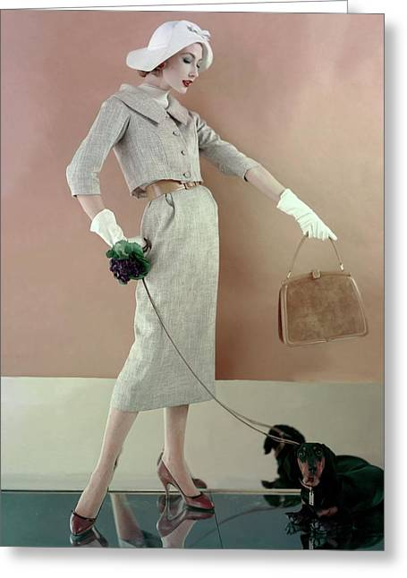 A Model Wearing A Tweed Jacket And Skirt Greeting Card by Karen Radkai