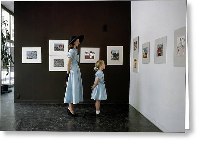 A Mother And Daughter At Moma Greeting Card by John Rawlings