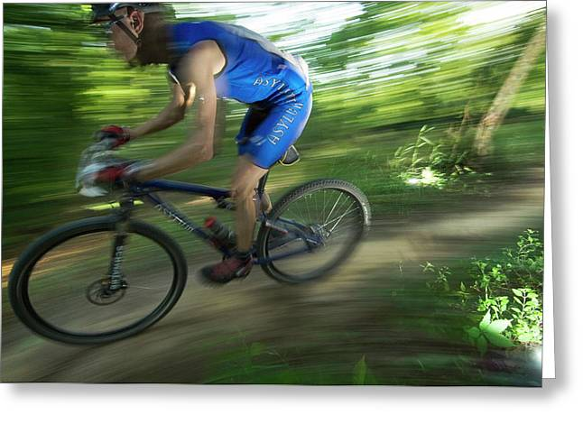 A Mountain Biker Races On A Trail Greeting Card