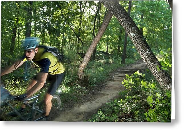 A Mountain Biker Speeds Down A Winding Greeting Card