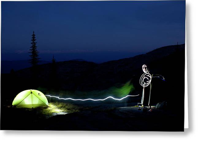 A Nighttime Light Painting Of A Glowing Greeting Card