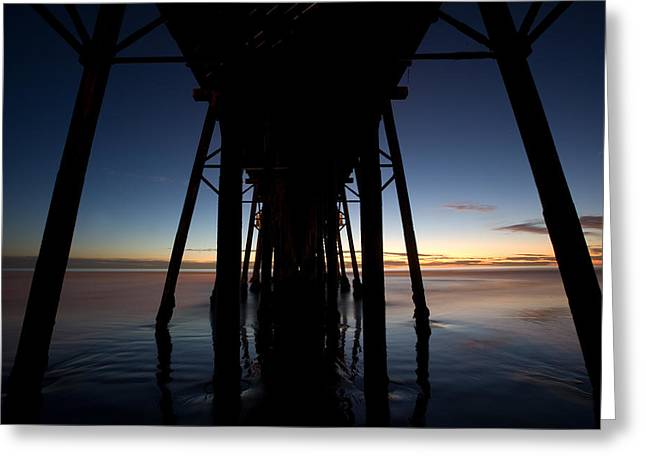 A Ocean Pier At Sunset In California Greeting Card by Peter Tellone