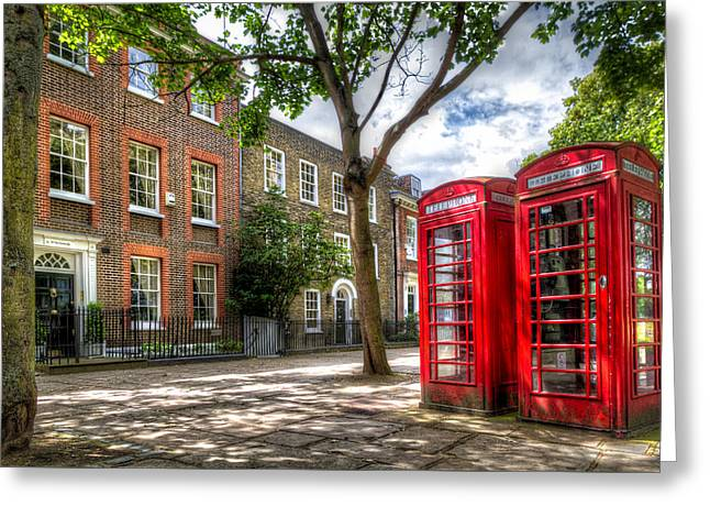 Greeting Card featuring the photograph A Pair Of Red Phone Booths by Tim Stanley