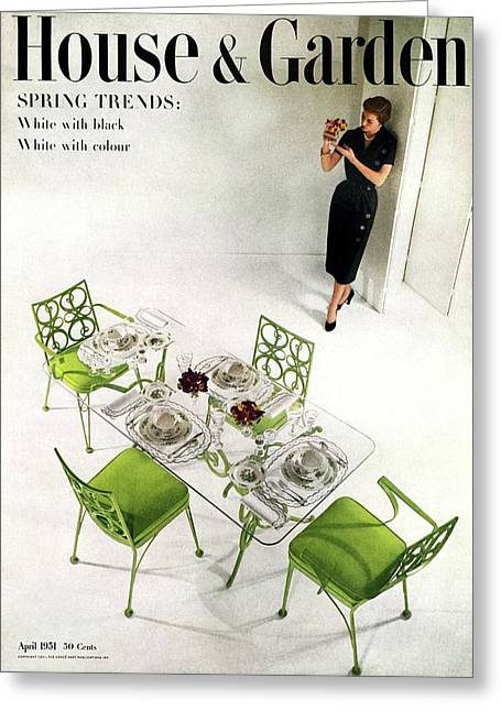 A Patio Table With A Model Standing Behind Greeting Card by Herbert Matter