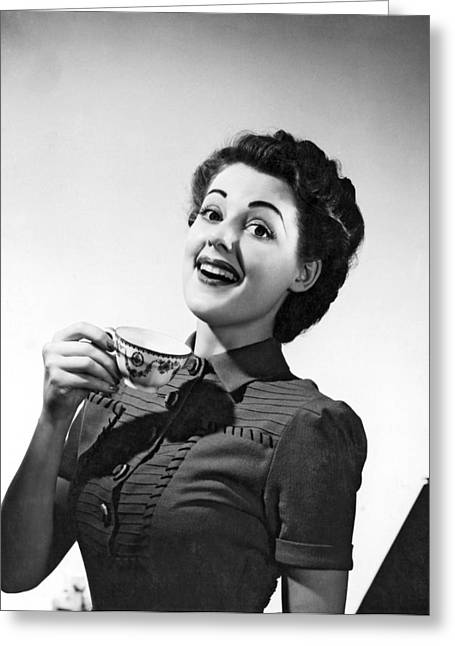 A Perky Woman Enjoys Her Cup Of Coffee. Greeting Card