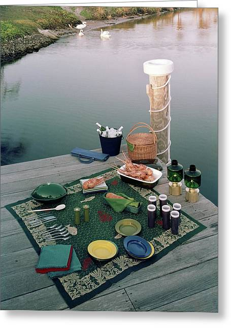A Picnic Set Up On A Dock Greeting Card