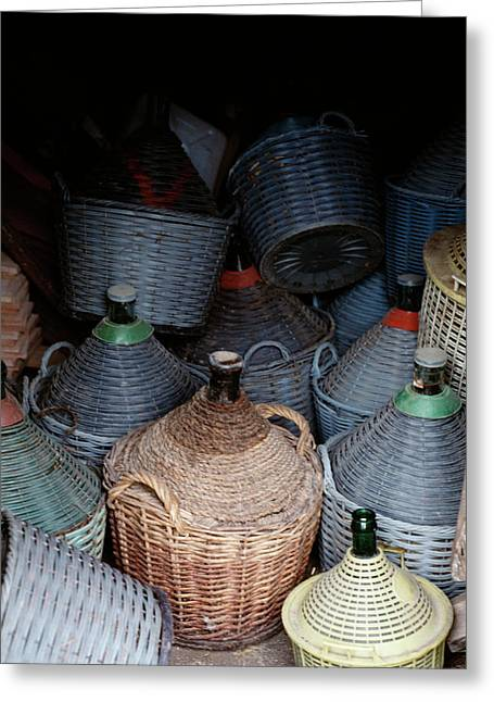 A Pile Of Old Wicker Covered Wine Greeting Card