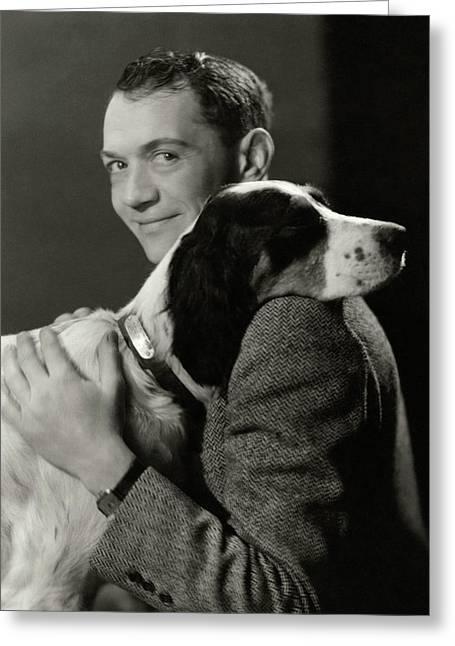 A Portrait Of John Held Jr. Hugging A Dog Greeting Card by Nicholas Muray