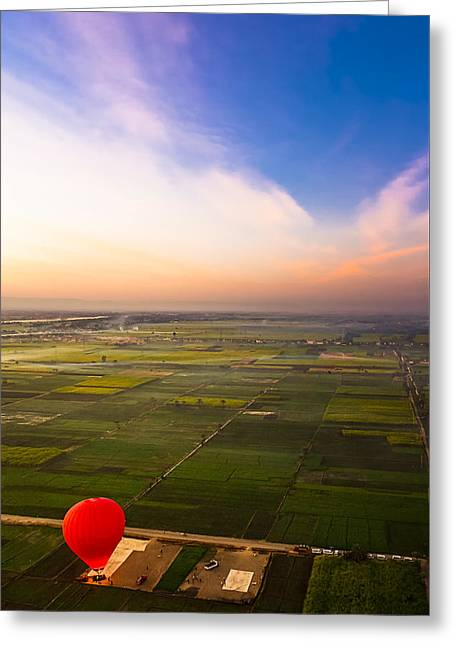 A Red Hot Air Balloon Landing In Egyptian Fields Greeting Card by Mark E Tisdale
