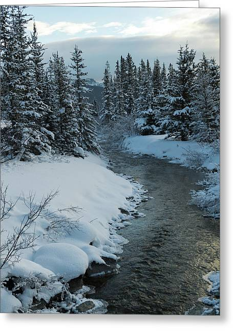A River Flowing Through A Snow Covered Greeting Card by Keith Levit