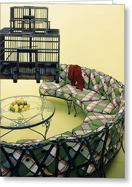 A Round Couch And A Birdcage Greeting Card