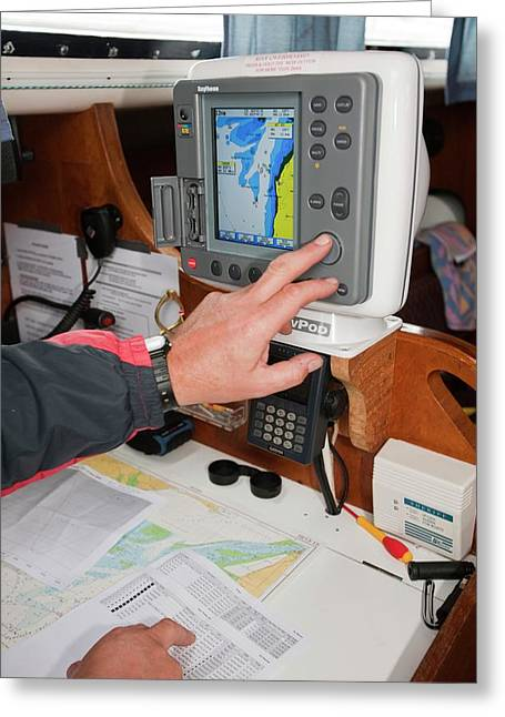 A Sailor Using Gps Navigation Equipment Greeting Card by Ashley Cooper