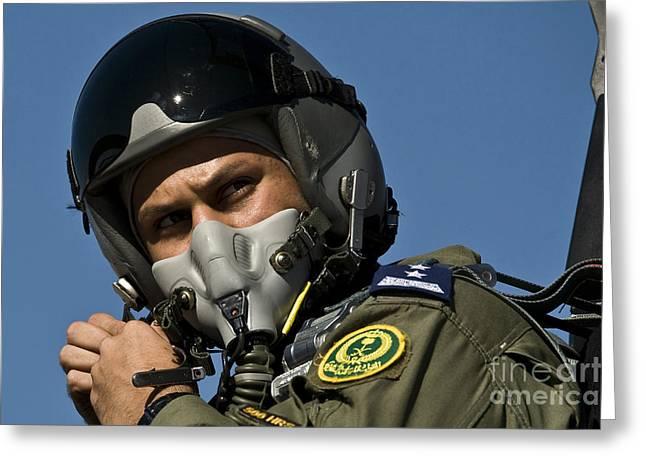 A Saudi Air Force Pilot Adjusts Greeting Card by Stocktrek Images