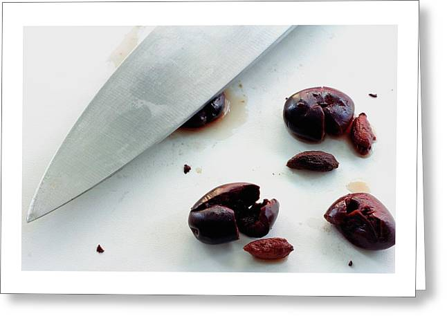 A Sharp Knife And A Group Of Olives Greeting Card
