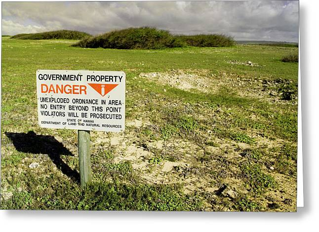 A Sign Warns Of Dangerous Unexploded Greeting Card