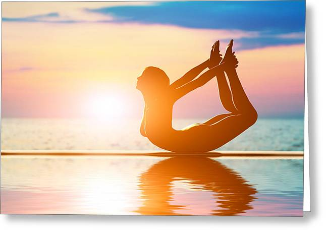 A Silhouette Of A Woman In Bow Yoga Position Meditating Greeting Card by Michal Bednarek