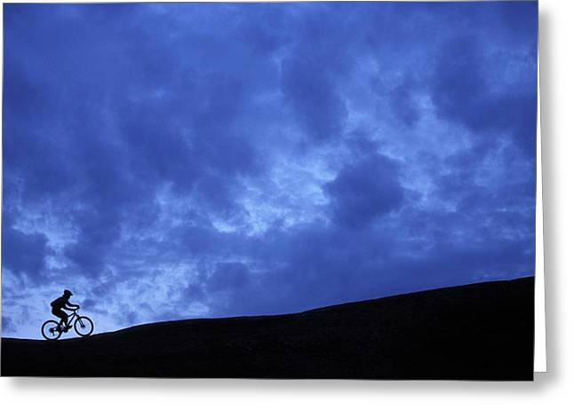 A Silhouette Of A Woman Mountain Biking Greeting Card