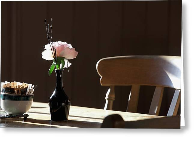 A Single Rose Sits In A Small Vase Greeting Card