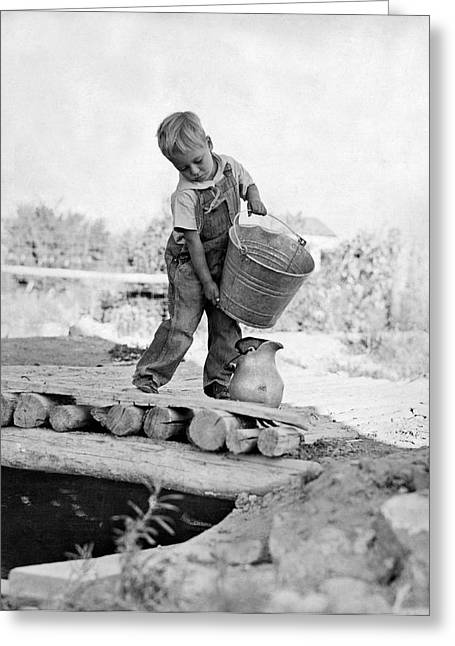 A Small Boy On A Farm Pours Water From A Bucket Into A Pitcher F Greeting Card
