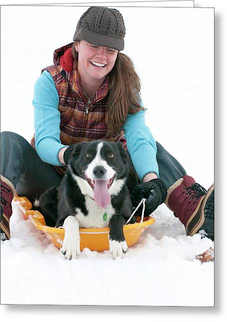 A Smiling Young Woman Rides A Sled Greeting Card