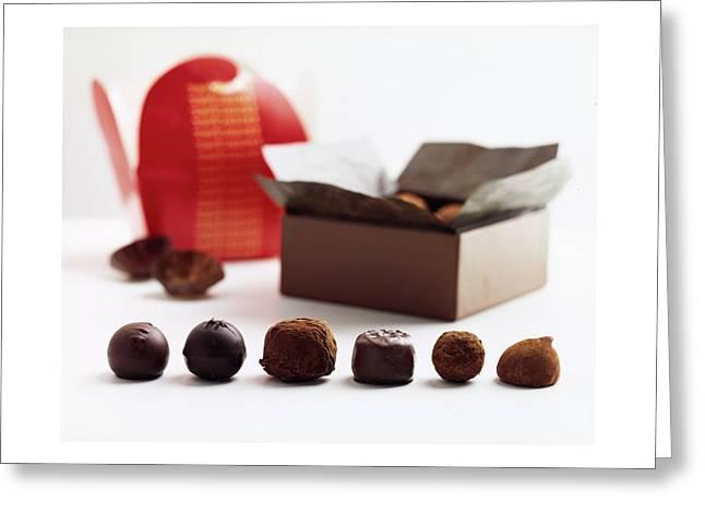 A Still Life Photo Of Gourmet Chocolates Greeting Card
