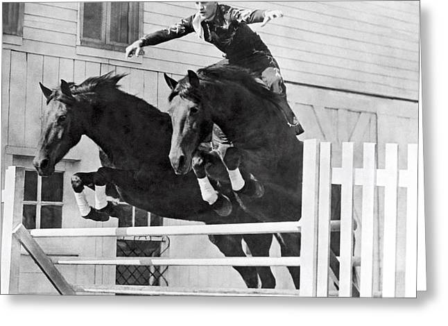 A Stunt Rider On Two Horses. Greeting Card