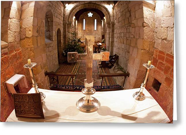 A Table At The Altar And A Decorated Greeting Card by John Short
