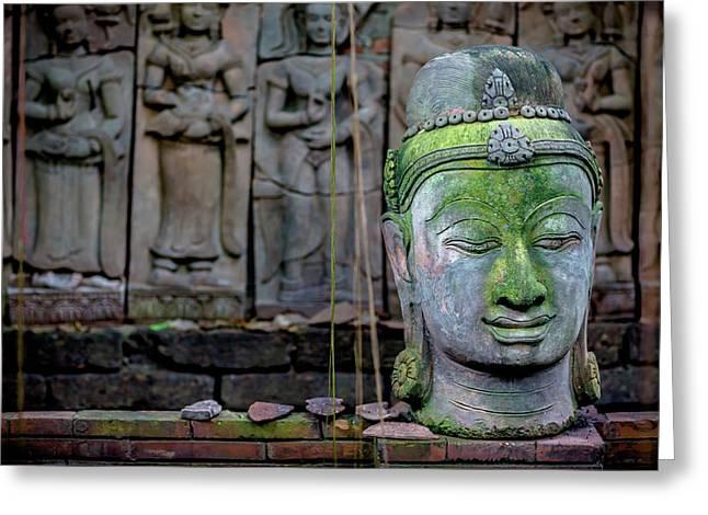 A Terra Cotta Head Of Buddha Sits Greeting Card by Matt Brandon