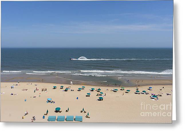 A Touring Speedboat Passes By Shore In Ocean City Maryland Greeting Card