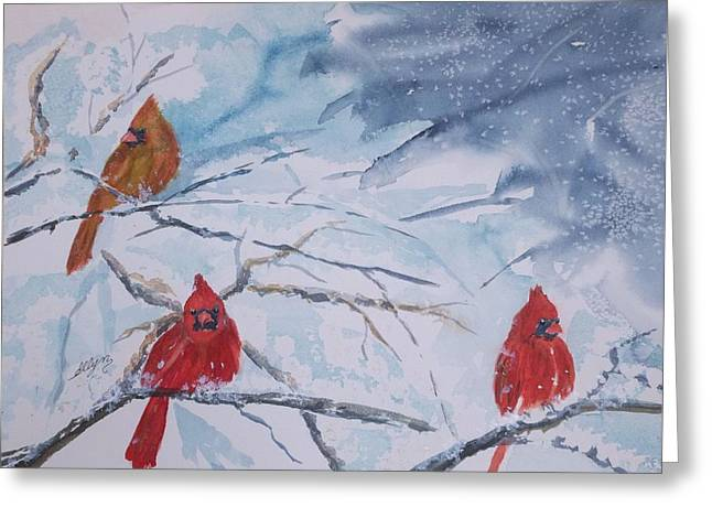 A Trio Of Cardinals Nestled In Snow Covered Branches Greeting Card