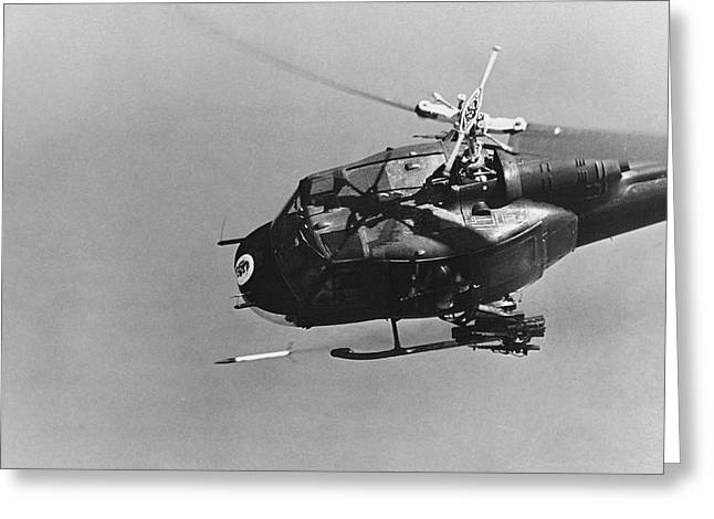 A Uh-1 Helicopter Gunship Fires Greeting Card by Stocktrek Images