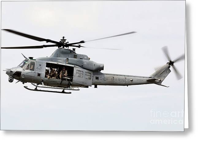 A Uh-1y Huey Hovers Around A Ship Greeting Card