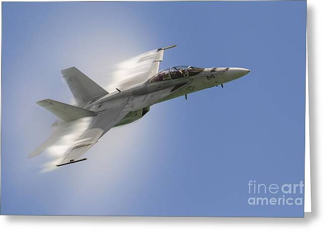 A U.s. Navy Fa-18f Performs A Fast Pass Greeting Card by Rob Edgcumbe