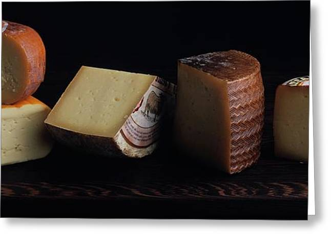 A Variety Of Cheese On A Cutting Board Greeting Card by Romulo Yanes