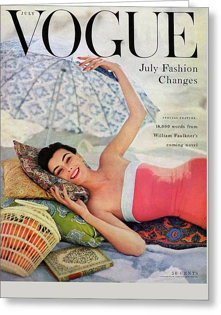 A Vogue Cover Of Anne Gunning Under An Umbrella Greeting Card by Karen Radkai