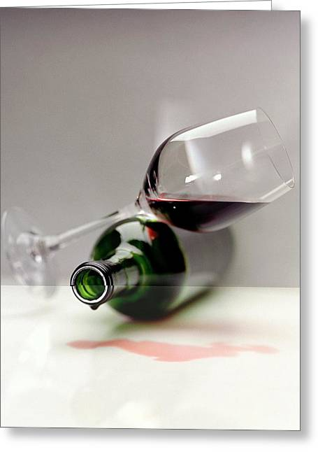 A Wine Bottle And A Glass Of Wine Greeting Card by Romulo Yanes