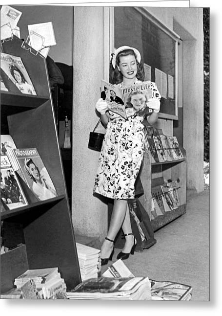 A Woman At A Magazine Stand Greeting Card by Underwood Archives