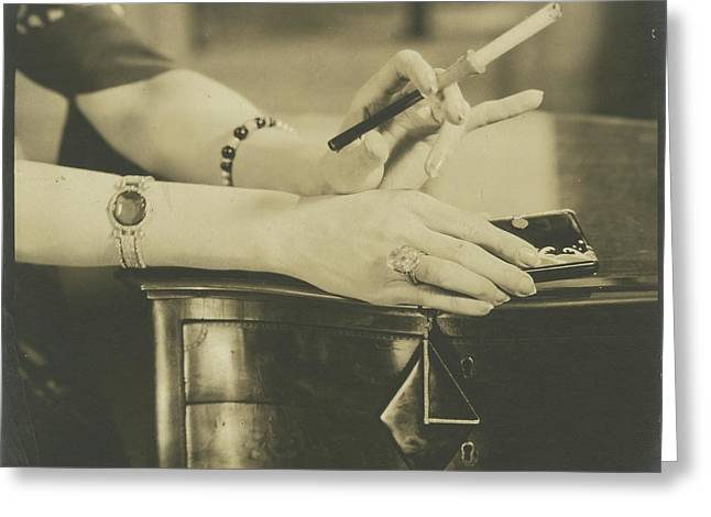 A Woman Holding A Cigarette Holder Greeting Card by Edward Steichen