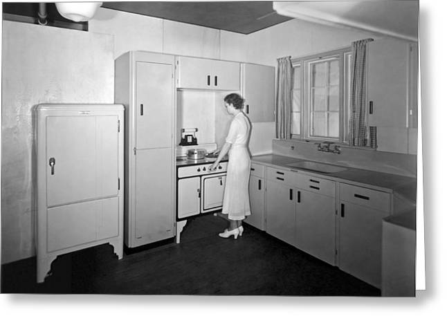 A Woman In Her Kitchen Greeting Card by Underwood Archives