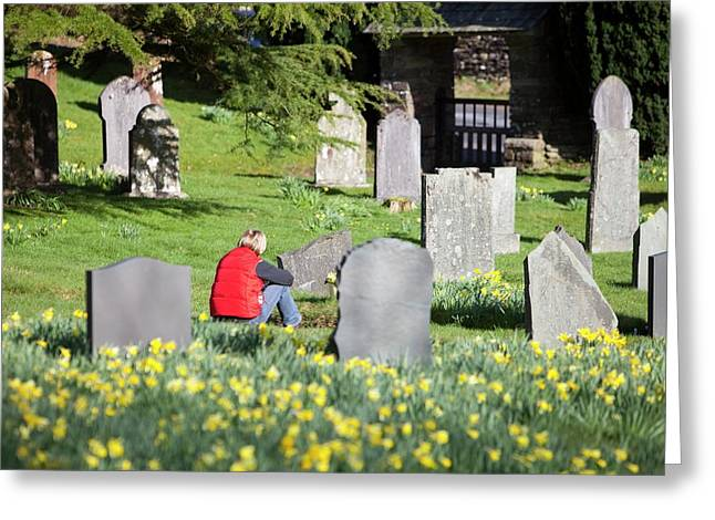 A Woman In Troutbeck Church Graveyard Greeting Card by Ashley Cooper