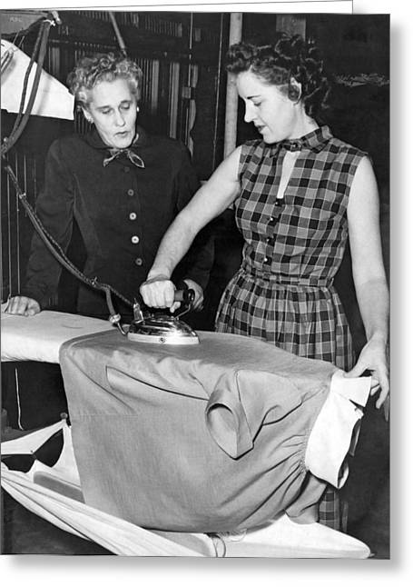 A Woman Irons A Shirt Greeting Card by Underwood Archives