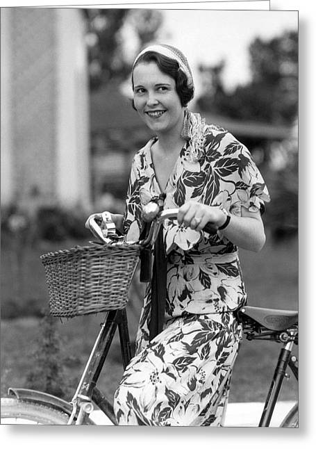 A Woman On A Bicycle Greeting Card