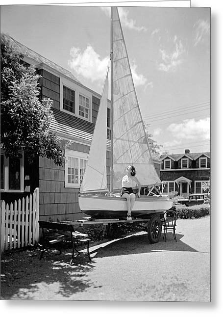 A Woman On Sailboat At Home Greeting Card by Underwood Archives