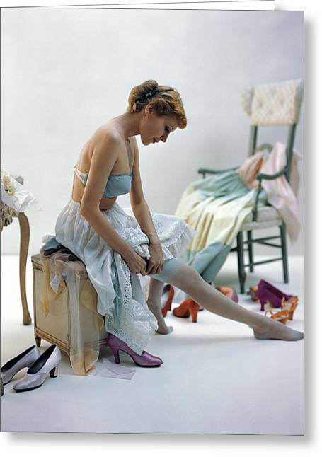 A Woman Putting On Her Stockings Greeting Card by John Rawlings