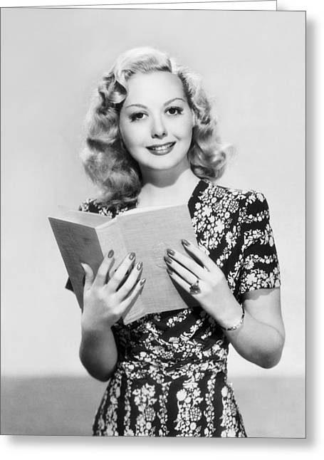 A Woman Reading A Book Greeting Card by Underwood Archives