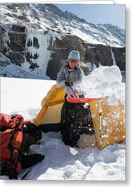 A Woman Shovelling Snow Away Greeting Card