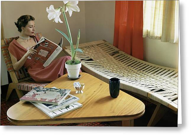 A Woman Sitting By A Coffee Table And Chaise Greeting Card by Horst P. Horst